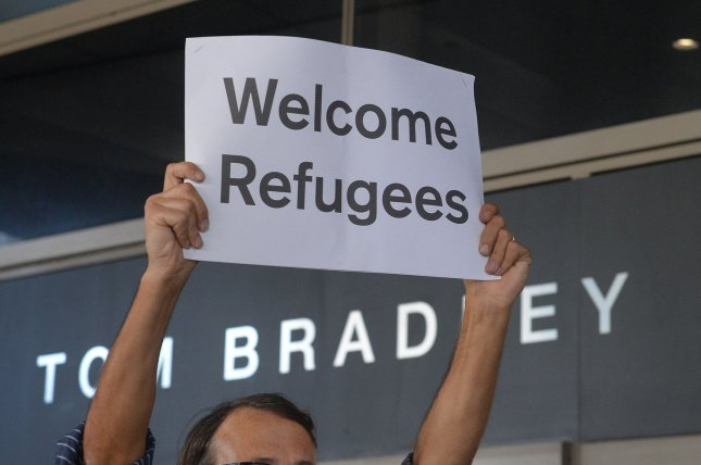 Demonstrators greet travelers arriving at Los Angeles International Airport to protest President Donald Trump's travel ban at Tom Bradley International Terminal at LAX in Los Angeles on June 29. The Supreme Court upheld a federal court judge's order broadening family members of immigrants from six Muslim-majority nations who can enter the country under President Donald Trump's temporary travel ban. Photo by Jim Ruymen/UPI