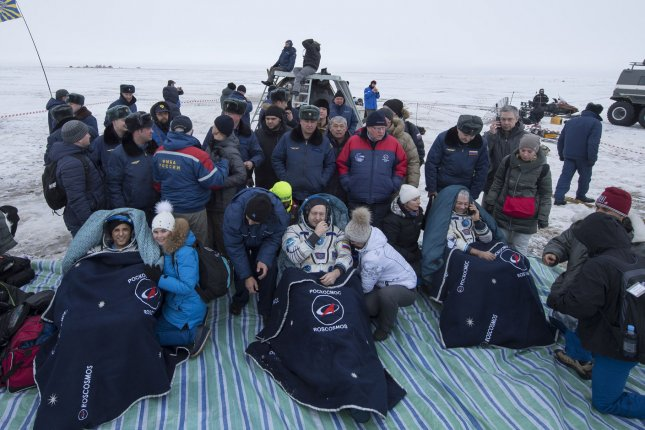 NASA astronaut Joe Acaba, left, Russian cosmonaut Alexander Misurkin, center, and NASA astronaut Mark Vande Hei sit in chairs outside the Soyuz MS-06 spacecraft after they landed in a remote area near the town of Zhezkazgan, Kazakhstan, on February 28, 2018 (February 27 Eastern time.) Acaba, Vande Hei, and Misurkin are returning after 168 days in space where they served as members of the Expedition 53 and 54 crews onboard the International Space Station. NASA Photo by Bill Ingalls/UPI