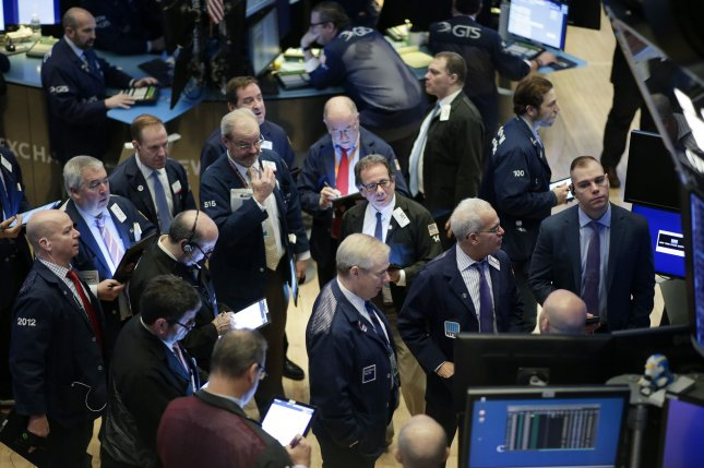 Traders work on the the floor of the New York Stock Exchange at the opening bell on Wall Street in New York City on Tuesday. Photo by John Angelillo/UPI