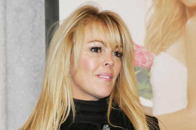 Dina Lohan flew to London on Jan. 21 to spend time with her daughter actress Lindsay Lohan after she was hospitalized. Dina Lohan appears picture on 2009. File photo by Laura Cavanaugh/UPI