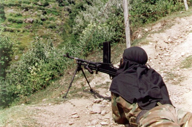 An Indian soldier guards the Line of Control that separates India from Pakistani-controlled Kashmir, March 21, 2000. Indian and Pakistani forces have sporadically exchanged heavy fire across the LoC since a 2003 ceasefire, including on Aug. 16, 2015, when firing in the Poonch district of Indian-administered Kashmir killed at least six civilians. cc/str UPI.
