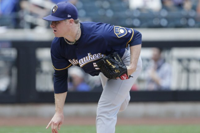 Milwaukee Brewers starting pitcher Chase Anderson throws a pitch in the first inning. File photo by John Angelillo/UPI