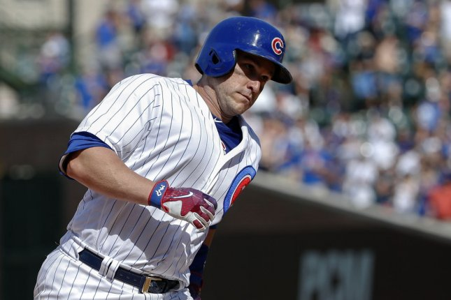 Former Chicago Cubs catcher Miguel Montero runs the bases after hitting a solo home run off Colorado Rockies relief pitcher Chad Qualls in the eight inning on June 11 at Wrigley Field in Chicago. Photo by Kamil Krzaczynski/UPI