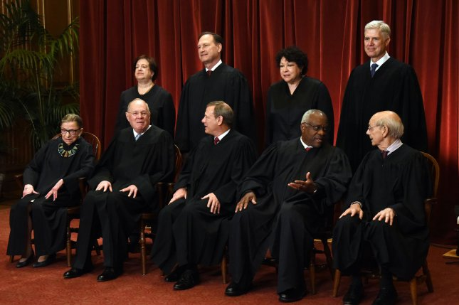 Members of the U.S. Supreme Court pose for a group photograph at the Supreme Court building on on June 1. They heard a case involving the FBI's use of cellphone tracking data without a warrant Wednesday. Photo by Olivier Douliery/UPI