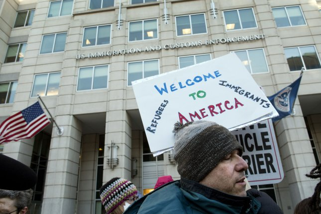 Immigration supporters protest the recent travel ban and illegal immigrant deportations outside the U.S. Immigration and Customs Enforcement Agency headquarters in Washington, D.C. on February 15, 2017. Photo by Kevin Dietsch/UPI