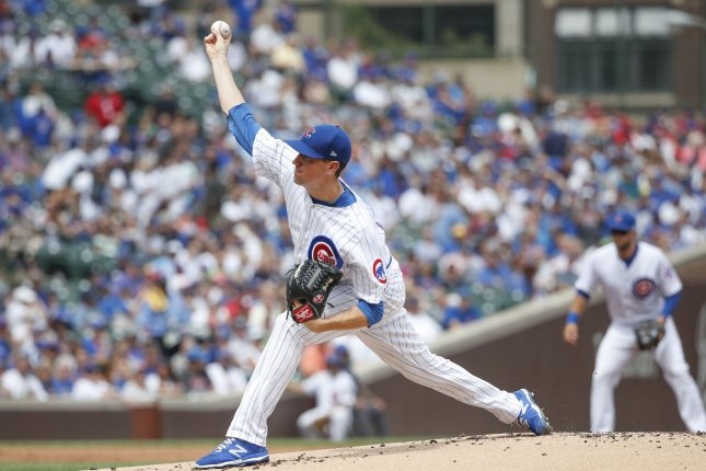Chicago Cubs starting pitcher Kyle Hendricks delivers against the Milwaukee Brewers in the first inning of a baseball game on August 15 at Wrigley Field in Chicago. Photo by Kamil Krzaczynski/UPI
