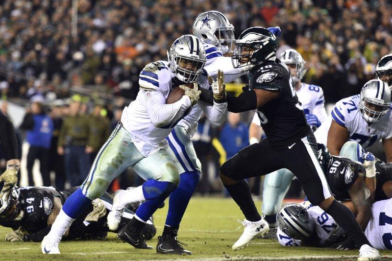Dallas Cowboys running back Ezekiel Elliott (21) runs for a touchdown past Philadelphia Eagles middle linebacker Jordan Hicks (58) during an NFL football game on November 11 at Lincoln Financial Field in Philadelphia. Photo by Derik Hamilton/UPI
