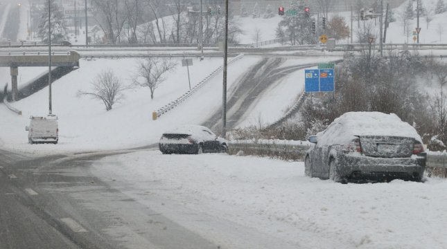 Abandoned cars litter the streets in St. Louis on Saturday. A winter storm that pounded St. Louis and left seven people dead mad its way east Sunday, leaving thousands without power on the Atlantic coast. Photo by Bill Greenblatt/UPI