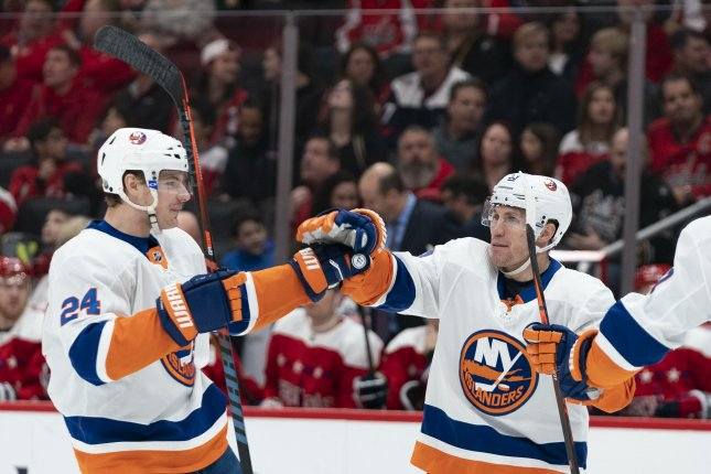 New York Islanders center Casey Cizikas (R) helped his squad come back and beat the Washington Capitals Tuesday in Washington, D.C.  Photo by Alex Edelman/UPI