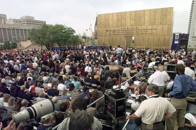 Families of survivors and rescue workers attend opening of the Oklahoma City bombing memorial April 19, 2000. File Photo by Bill Carter/UPI