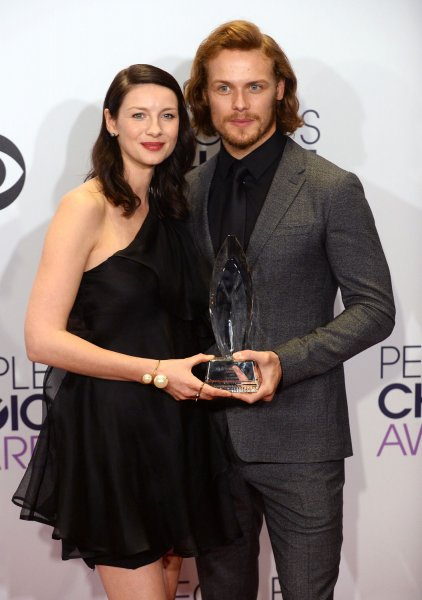 Caitriona Balfe (L) and Sam Heughan confirmed Sunday they will return for Season 7 of Outlander. File Photo by Jim Ruymen/UPI