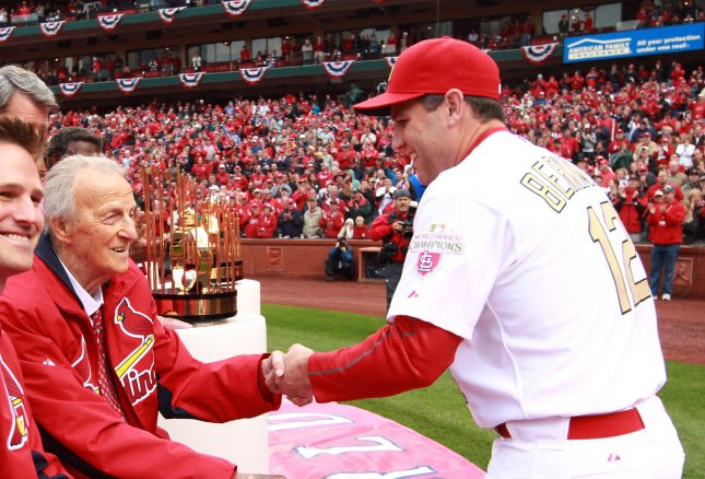 St. Louis Cardinals first baseman Lance Berkman shakes the hand of Hall of Fame member Stan Musial during Opening Day ceremonies at Busch Stadium in St. Louis on April 13, 2012. UPI/Bill Greenblatt