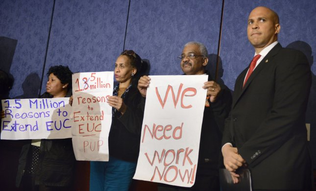 US Sen. Cory Booker (D-NJ), (R), stands with labor leaders during a press briefing to rally support for Congress to renew unemployment insurance benefits, which earlier failed to pass because of Republican opposition, at the US Capitol, January 16, 2014, in Washington, DC. UPI/Mike Theiler