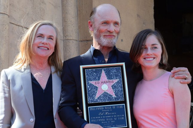 Actor Ed Harris holds a replica plaque while he poses with his wife, actress Amy Madigan (L) and their daughter Lily Dolores Harris during an unveiling ceremony honoring him with the 2,546th star on the Hollywood Walk of Fame in Los Angeles on March 13, 2015. Photo by Jim Ruymen/UPI