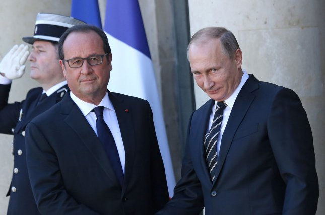 Russian President Vladimir Putin, right, is greeted by French President Francois Hollande on Friday at the Elysee Palace in Paris on October 2, 2015. Putin and Hollande were in Paris to meet with German Chancellor Angela Merkel and Ukrainian President Petro Poroshenko to discuss a lasting political solution in Ukraine, in accordance with the Minsk accords established by these 4 leaders earlier this year. Photo by David Silpa/UPI