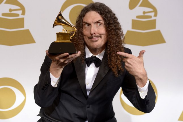 Singer Weird Al Yankovic, winner of Best Comedy Album for Mandatory Fun, poses at the 57th Grammy Awards in Los Angeles last year. File Photo by Phil McCarten/UPI
