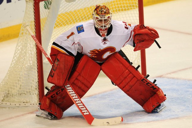 Caglary Flames goaltender Brain Elliott protects his goal against his former team the St. Louis Blues, in the first period at the Scottrade Center in St. Louis on October 25, 2016. Elliott celebrated his return to St. Louis by stopping 22 of 23 shots to lead Calgary to the win. Photo by Bill Greenblatt/UPI