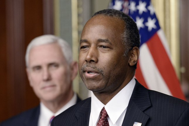 Housing and Urban Development Secretary Ben Carson speaks after being sworn in on March 2, as Vice President Mike Pence looks on. Monday, Carson drew criticism for remarking to HUD staff that African-American slaves were immigrants. Pool photo by Olivier Douliery/UPI