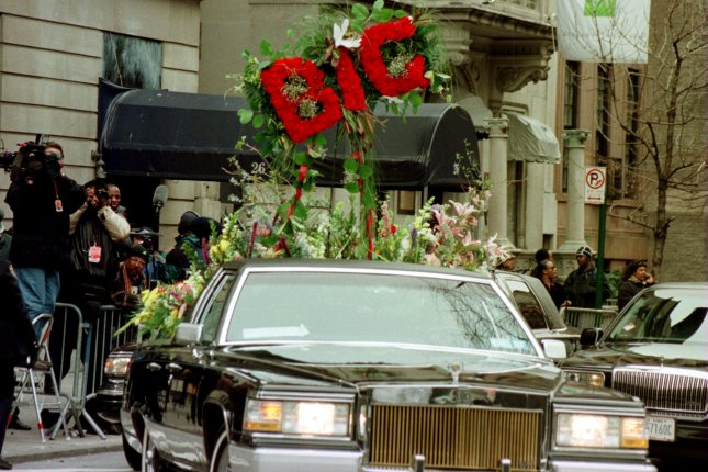 The lead flower car for the funeral procession of rapper Notorious B.I.G., aka Christopher Wallace, leaves Campbells Funeral Home in Manhattan, on March 18, 1997, after services. Wallace died March 9, 1997, in a drive-by shooting. File Photo by Ezio Petersen/UPI
