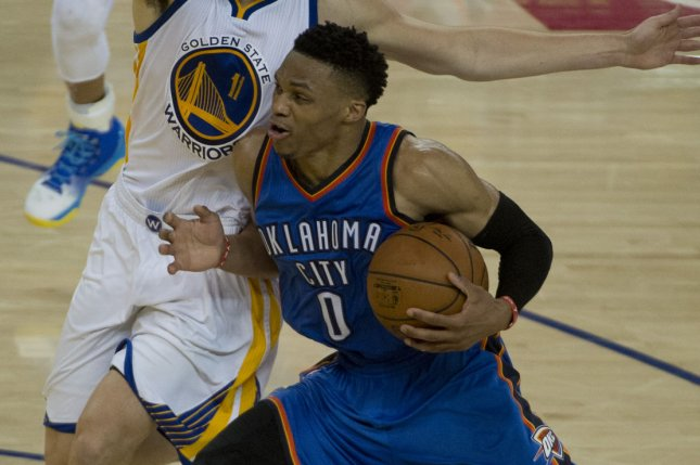 Oklahoma City Thunder point guard Russell Westbrook drives to the basket during a game against the Golden State Warriors. Photo by Terry Schmitt/UPI