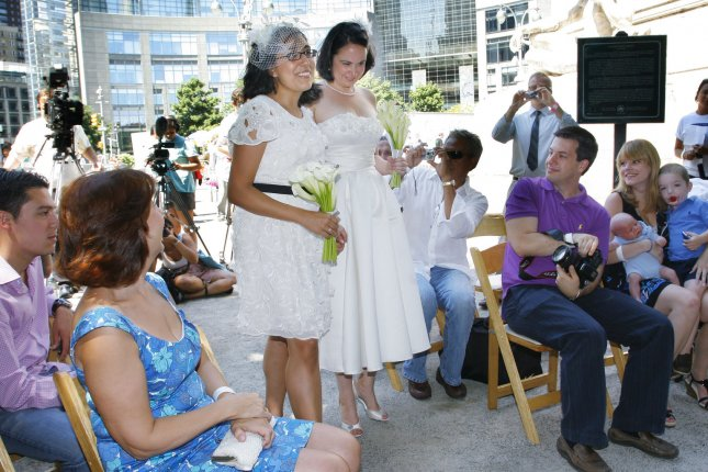 Since 2015, when the U.S. Supreme Court ruled that same-sex couples could marry legally in the United States, almost 300,000 same-sex weddings have pumped billions of dollars into local and state economies, a new study shows. File photo by Monika Graff/UPI