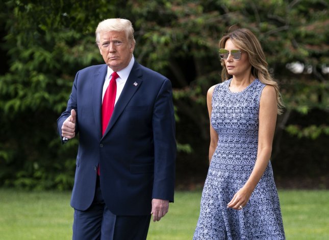 President Donald Trump signed an executive order to support child welfare Wednesday in the Oval Office at the White House with first lady Melania Trump on hand. Photo by Kevin Dietsch/UPI