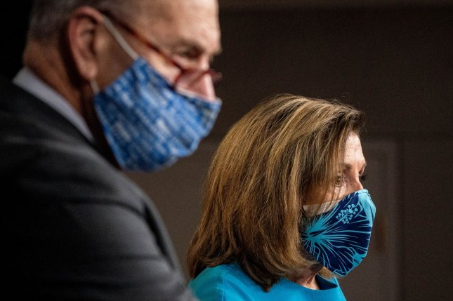 House Speaker Nancy Pelosi and Senate Democratic leader Chuck Schumer backed a $908 billion pandemic relief bill introduced by a bipartisan group of lawmakers Wednesday. File Photo by Ken Cedeno/UPI