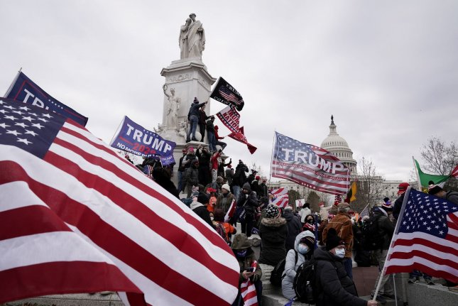 Supporters of President Donald Trump breach the security perimeter of the U.S. Capitol on January 6.  Photo by Ken Cedeno/UPI