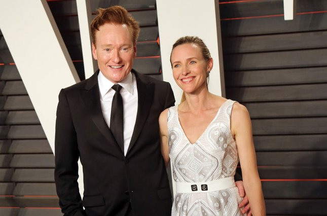 Conan O'Brien (L) and his wife, Liza Powel, attend the 2016 Vanity Fair Oscar Party in February 2016. O'Brien hosted the final episode of Conan on TBS. File Photo by David Silpa/UPI