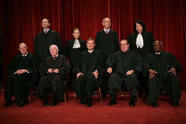 The Supreme Court Justices of the United States posed for their official family group photo and then allowed members of the media to take photos afterward on September 29, 2009, at the Supreme Court in Washington. The justices are John G. Roberts (Chief Justice), John Paul Stevens, Antonin Scalia, Anthony Kennedy, Clarence Thomas, Ruth Bader Ginsburg, Stephen Breyer, Samuel Alito, Sonia Sotomayor. UPI/Gary Fabiano/Pool