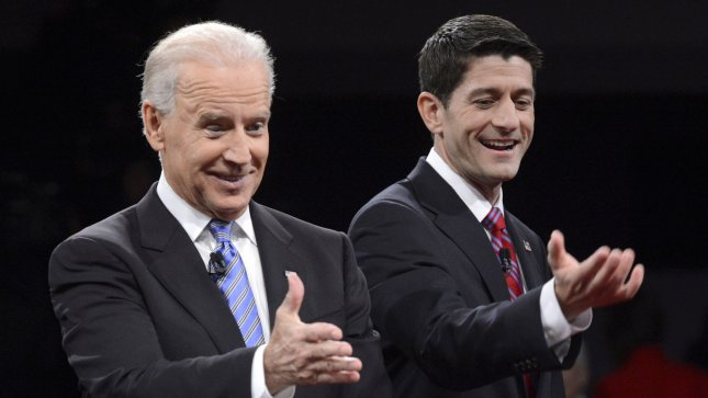 Vice-President Joe Biden (L) and Republican Vice-President nominee Paul Ryan stand on stage at the Vice-Presidential debate at Centre College on October 11, 2012 in Danville, Kentucky.. UPI/Michael Reynolds POOL