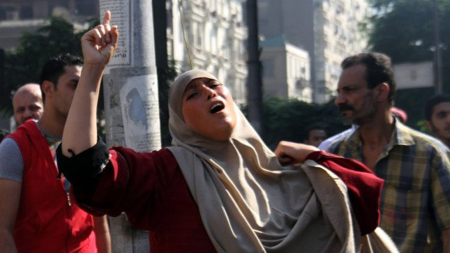 Egyptian woman cry after killing her relative after clashes broke out during a demonstration in support of Egypt's ousted president Mohamed Morsi, in Cairo Egypt on August 16, 2013. Muslim Brotherhood protests plunged into violence across Egypt on Friday, with around 50 killed in Cairo alone on a Day of Rage called by Islamist followers of ousted President Mohamed Mursi to denounce a police crackdown. UPI/Ahmed Jomaa