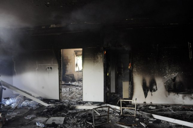 A burnt building is seen at the United States consulate, one day after armed men stormed the compound and killed the U.S. Ambassador Christopher Stevens and three others in Benghazi, Libya on September 12, 2012. The gunman were protesting a little known film by an American amateur filmmaker that angered Muslims as it was deemed insulting to the Prophet Mohammad. UPI/Tariq AL-hun