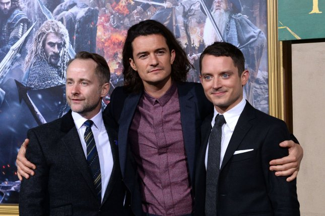 Elijah Wood (R) with Billy Boyd (L) and Orlando Bloom at the Los Angeles premiere of The Hobbit: The Battle of the Five Armies on December 9, 2014. File Photo by Jim Ruymen/UPI