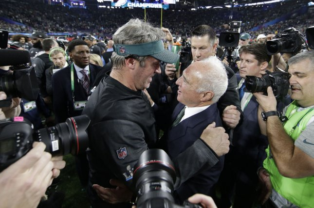 Philadelphia Eagles head coach Doug Pederson (L) gives owner Jeffrey Lurie (R) a hug after Super Bowl LII on February 4, 2018 at U.S. Bank Stadium in Minneapolis, Minnesota. Photo by John Angelillo/UPI