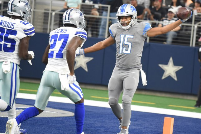 Former Detroit Lions wide receiver Golden Tate celebrates his 45-yard touchdown catch in the first quarter against the Dallas Cowboys on September 30 at AT&T Stadium in Arlington, Texas. Photo by Ian Halperin/UPI