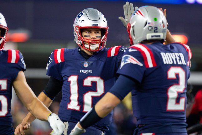 New England Patriots quarterback Tom Brady (12) gets a high five from quarterback Brian Hoyer (2) after Brady threw a touchdown pass in the fourth quarter against the Green Bay Packers at Gillette Stadium in Foxborough, Mass. on Sunday. Photo by Matthew Healey/UPI