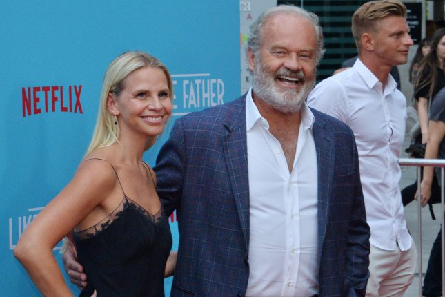 Kelsey Grammer (R) and his wife Kayte Walsh. Grammer discussed a potential revival of Fraiser on The Late Late Show. File Photo by Jim Ruymen/UPI