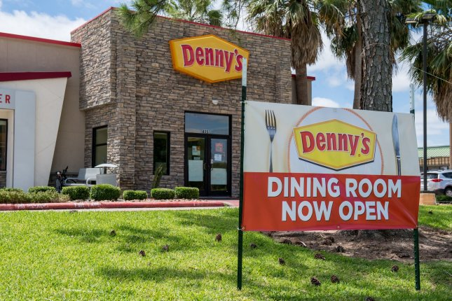 A sign in front of a Denny's restaurant in Lake Jackson, Texas, on Sunday informs customers the dining room is now open. More states began allowing businesses to reopen on Monday. Photo by Trask Smith/UPI