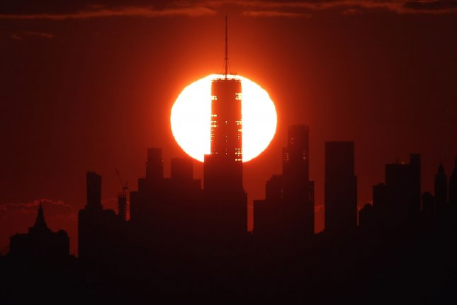 The sun rises behind One World Trade Center and the Manhattan skyline in New York City on January 17, as seen from West Orange, N.J. File Photo by John Angelillo/UPI