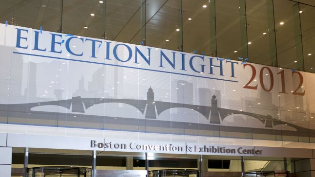 Workers hang an Election Night sign above the entrance of the window Boston Convention and Exhibition Center in preparation for Republican Presidential Candidate Mitt Romney's election night rally at the center, in Boston November 4, 2012. On Tuesday, November 6 Americans will head to the polls to elect the next President of the United States. UPI/Kevin Dietsch