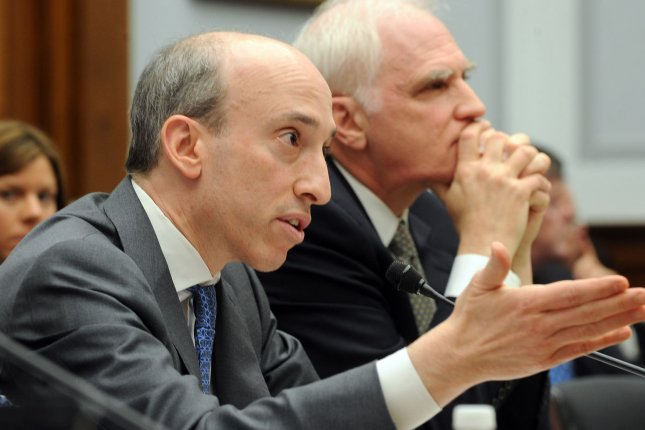 Commodity Futures Trading Commission Chairman Gary Gensler's term expires in January, but the regulator's headaches rise as it faces a new lawsuit from Wall Street . (FileUPI/Roger L. Wollenberg)