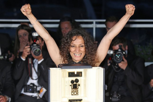 Houda Benyamina arrives at the award photo call after receiving the Camera d'Or prize for the film Divines during the 69th annual Cannes International Film Festival on May 22, 2016. Photo by David Silpa/UPI