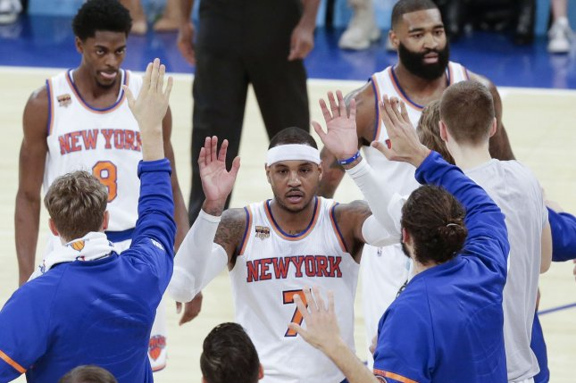 New York Knicks Carmelo Anthony (7) scored 33 points and knocked down two free throws with 14.8 seconds left as the New York Knicks held on to beat the Sacramento Kings 103-100 on Friday night. Photo by John Angelillo/UPI