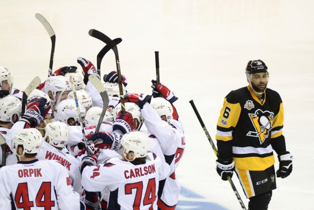 Pittsburgh Penguins defenseman Trevor Daley (6) skates pass the celebrating Washington Capitals following the overtime goal of Washington Capitals defenseman Kevin Shattenkirk that gives the Capitals the 3-2 win in game three in the second round of the Stanley Cup Playoffs at PPG Paints Arena in Pittsburgh on May 1, 2017. Photo by Archie Carpenter/UPI