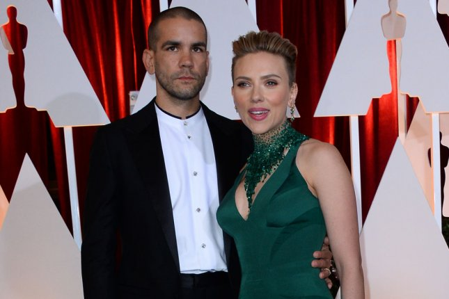 Scarlett Johansson (R) and Romain Dauriac attend the Academy Awards on February 22, 2015. The former couple settled their divorce and custody dispute this week. File Photo by Jim Ruymen/UPI