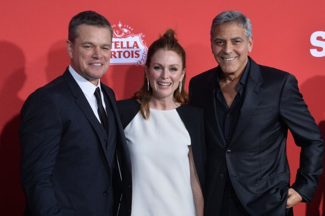 (L-R) Matt Damon and George Clooney, pictured here with Julianne Moore, have slammed Harvey Weinstein in an interview with Good Morning America. File Photo by Jim Ruymen/UPI