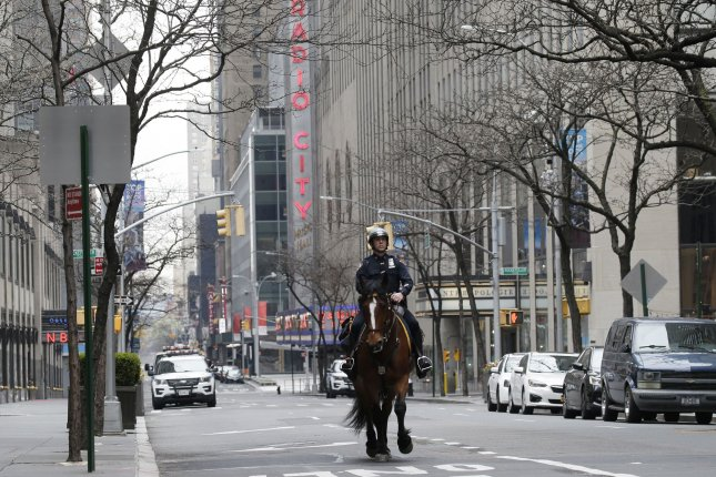 A New York City Police Department officer rides on horseback near Radio City Music Hall In New York City on Sunday. Photo by John Angelillo/UPI