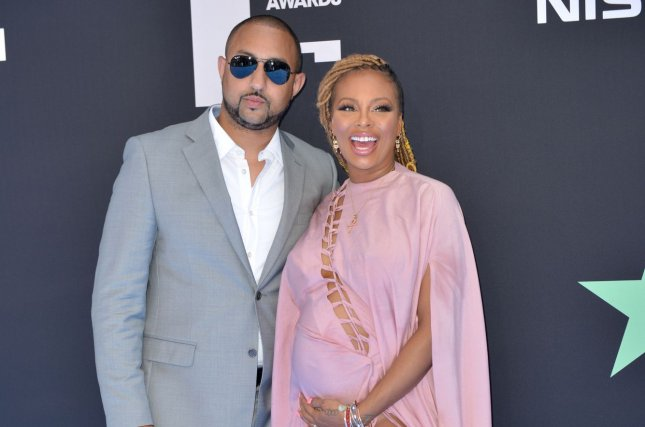 Eva Marcille (R), pictured with Michael Sterling, announced her exit from Real Housewives of Atlanta after three seasons. File Photo by Christine Chew/UPI