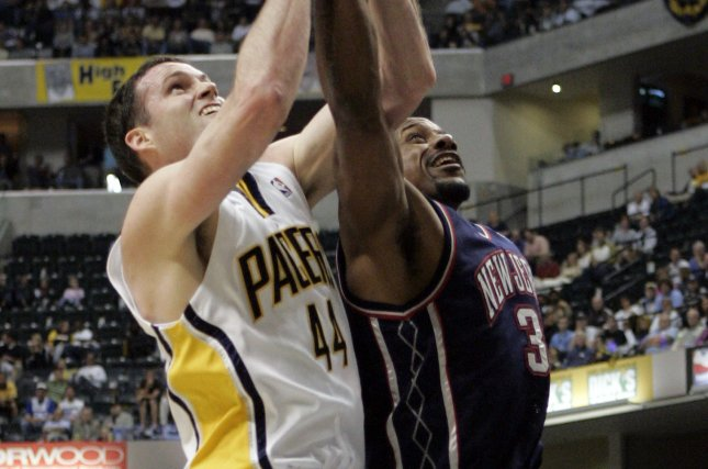 Indiana Pacers forward Austin Croshere (44) and New Jersey Nets center Cliff Robinson (30) battle for a rebound during the first half of game 3 of their first round playoff series at Conseco Fieldhouse in Indianapolis, In this 2006 file photo. Robinson died Saturday at 53. Photo by Mark Cowan/UPI